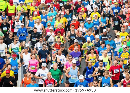 STOCKHOLM - MAY 31: Group of runners after the start of ASICS Stockholm Marathon 2014. May 31, 2014 in Stockholm, Sweden. - stock photo