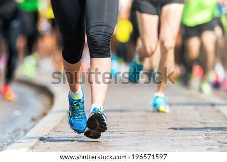 STOCKHOLM - MAY 31: Legs and feet closup in ASICS Stockholm Marathon 2014. May 31, 2014 in Stockholm, Sweden. - stock photo