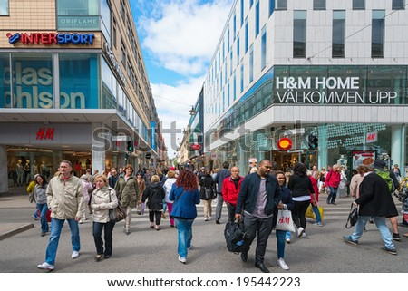 STOCKHOLM - MAY 27: The shopping street Drottningatan during day. May 27, 2014 in Stockholm, Sweden. Drottningatan is one of the most famous shopping streets in Stockholm. - stock photo