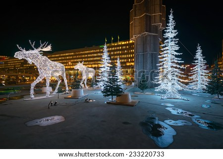 STOCKHOLM - 25 NOV: Christmas decorations in forms of a Moose family in the city centre of Stockholm. 25 November 2014, Sweden. Sergels torg during renovation - stock photo