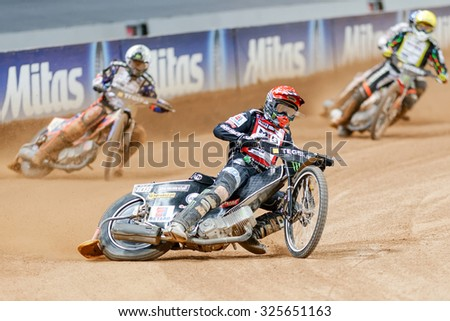 STOCKHOLM - SEPT 26, 2015: Action image of a Tai Woffinden leading a group of speedway racers into a curve at the TEGERA Stockholm FIM Speedway Grand Prix at Friends Arena in Stockholm. - stock photo