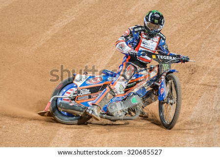 STOCKHOLM - SEPT 25, 2015: Greg Hancock from USA in a curve at the TEGERA Stockholm FIM Speedway Grand Prix at Friends Arena in Stockholm. - stock photo