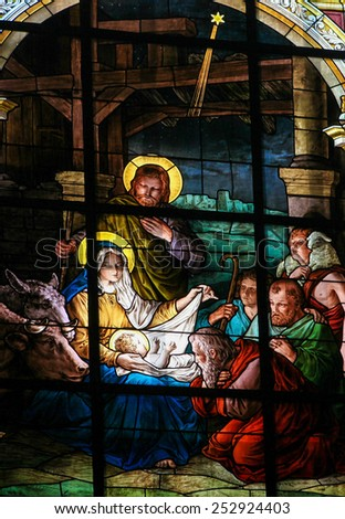 STOCKHOLM, SWEDEN - APRIL 16, 2010: Stained glass window created by F. Zettler (1878-1911) at the German Church (St. Gertrude's church) in Gamla Stan in Stockholm, depicting the Adoration by the Sheph - stock photo