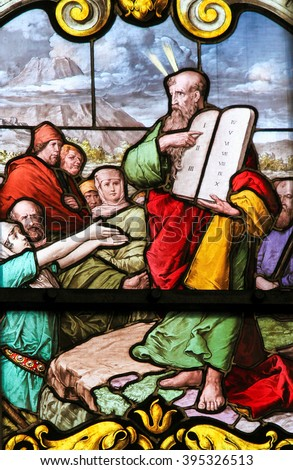 STOCKHOLM, SWEDEN - APRIL 16, 2010: Stained glass window depicting Moses with the Stone Tablets in Saint James's Church in Stockholm, Sweden. - stock photo