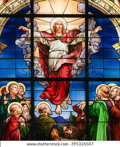 STOCKHOLM, SWEDEN - APRIL 16, 2010: Stained glass window in the German Church in Stockholm Sweden, depicting the Ascension of Christ. - stock photo