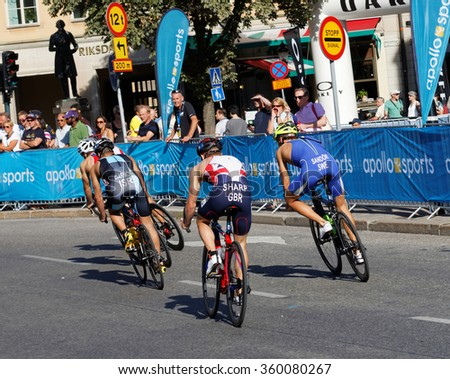 STOCKHOLM, SWEDEN - AUG 23, 2015: Rearl view of four triathlon cyclists including Matthew Sharp in in the Men's ITU World Triathlon series event August 23, 2015 in Stockholm, Sweden - stock photo