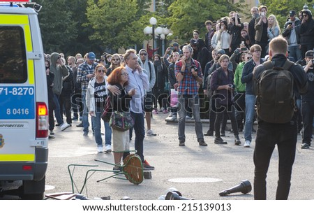 STOCKHOLM, SWEDEN - AUGUST 30: Protest againsts Neo-Nazi demonstration. The mood is bitter and some are trying to calm down a group of counter-demonstrators in Stockholm city, Sweden, August 30, 2014. - stock photo