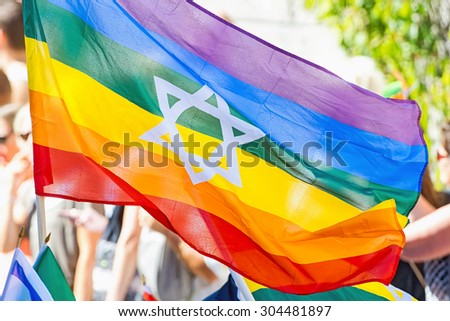 STOCKHOLM, SWEDEN - AUGUST 1, 2015: The rainbow flag with the star of David at the Pride parade in Stockholm. Approx 400.000 spectators at the streets. - stock photo