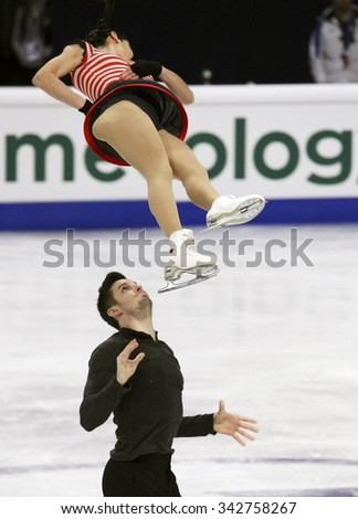 STOCKHOLM, SWEDEN -   FEBRUARY 1, 2015: Valentina MARCHEI / Ondrej HOTAREK of Italy perform during pair's free skating event at ISU European Figure Skating Championship in Globen Arena. - stock photo
