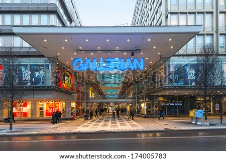 STOCKHOLM, SWEDEN - JAN 30; The entrance to Gallerian built in the 1970s and is the concept of a mall that has been copied since then. 2014 in Stockholm, Sweden. The Gallerian is a indoor mall. - stock photo