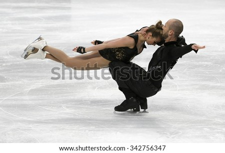 STOCKHOLM, SWEDEN - JANUARY 29, 2015: Nelli ZHIGANSHINA / Alexander GAZSI of Germany perform during ice dance free skating at ISU European Figure Skating Championship in Globen Arena. - stock photo