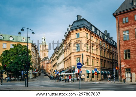 STOCKHOLM, SWEDEN - JULY 29, 2014: Storkyrkobrinken Street and Church of St. Nicholas - Storkyrkan (The Great Church) - Stockholms domkyrka Stockholm Cathedral), is the oldest church in Gamla Stan. - stock photo