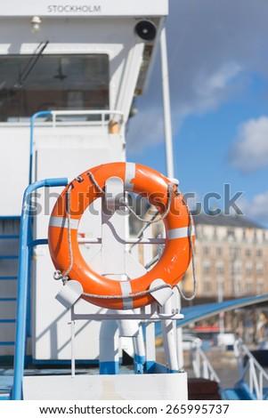 STOCKHOLM, SWEDEN - MAR 31: Lifebouy on a ship at dock in Stockholm, March 31, 2015 in Stockholm, Sweden. - stock photo