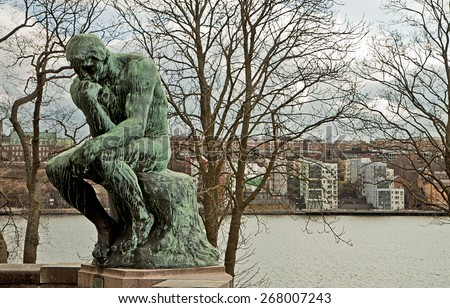 STOCKHOLM, SWEDEN - MARCH 28, 2015. The Thinker by Rodin free to admire at Stockholm Waldemarsudde public garden. The statue was commissioned by Prince Eugen to Rodin and delivered on 1908. - stock photo