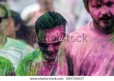 STOCKHOLM, SWEDEN - MAY 23: Colorful man with glasses at Stockholm Color Run in Tantolunden or Tanto on May 23, 2015. People from all walks of life participated in the run. - stock photo