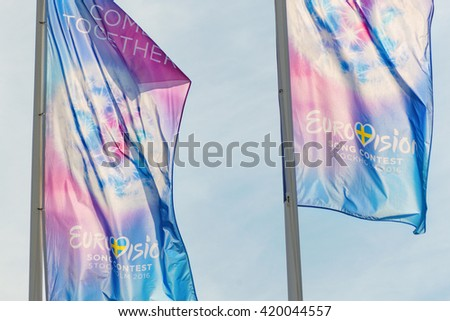 STOCKHOLM, SWEDEN - MAY 13, 2016: Eurovision club with a row of flags at the Royal castle in Stockholm during the ESC week. - stock photo