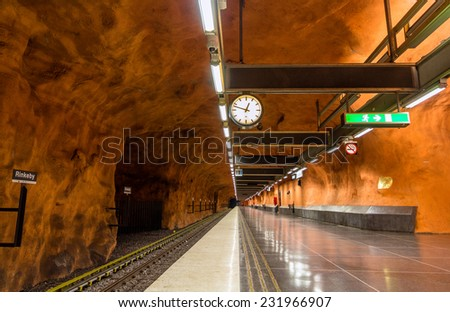 "STOCKHOLM, SWEDEN - MAY 30: Interior of Rinkeby station on May 30, 2014 in Stockholm metro. The metro system is called ""the world's longest art gallery"" with generously decorated stations. - stock photo"