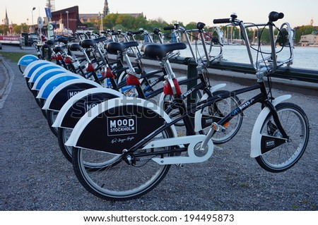 STOCKHOLM, SWEDEN- MAY 22, 2014 - Shared bikes are lined up in the streets of Stockholm, Sweden. Stockholm City Bikes, launched in 2006, has over 110 stations throughout Stockholm. - stock photo