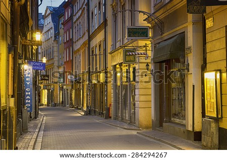 STOCKHOLM, SWEDEN - MAY 27: The touristic street of Gamla Stan - historic city old center of Stockholm, at summer night, with lanterns, May 27, 2015 in Stockholm, Sweden. - stock photo