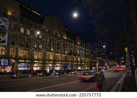 STOCKHOLM, SWEDEN - 30 NOV: Christmas decorations at Hamngatan in the center of Stockholm in Sweden. The famous store NK is illuminated. Photo taken on 30 November 2014 at Stockholm, Sweden. - stock photo