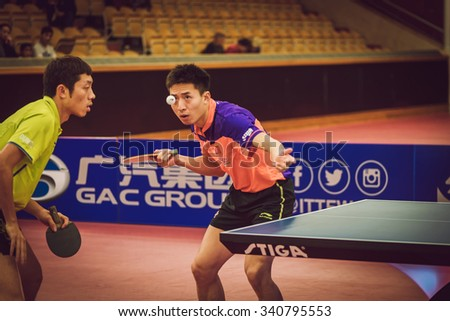 STOCKHOLM, SWEDEN - NOV 15, 2015: Final match in double between Zhendong, Jike (CHI) and Bo, Xin (CHI) at the table tennis tournament SOC at the arena Eriksdalshallen. - stock photo