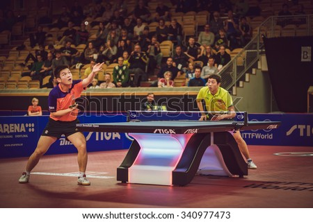 STOCKHOLM, SWEDEN - NOV 15, 2015: Finals between Fan Zhendong (CHI) and Xu Xin (CHI) in table tennis tournament SOC at the arena Eriksdalshallen. - stock photo