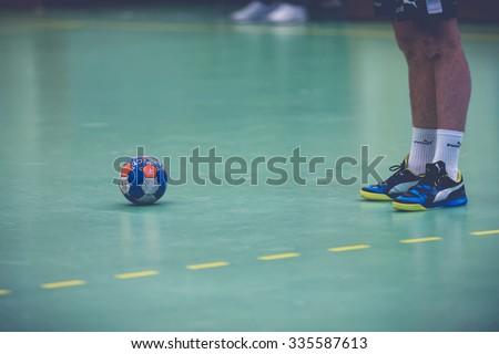 STOCKHOLM, SWEDEN - NOV 4, 2015: Legs and feet of a player and ball at the Handball game between Hammarby vs Lugi at Eriksdalshallen. Allsvenskan Swedish leugue - stock photo