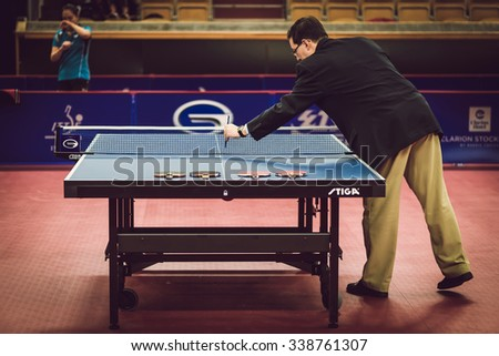 STOCKHOLM, SWEDEN - NOV 11, 2015: Referee checking at table tennis tournament SOC in the arena Eriksdalshallen. Swedish Open Championships - stock photo