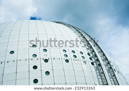 STOCKHOLM, SWEDEN - SEPTEMBER 9, 2014 - Architectural detail of the modern Ericsson Globe on a cloudy day in Stockholm - stock photo