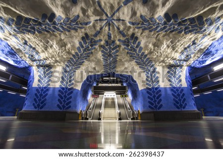STOCKHOLM, SWEDEN â?? SEPTEMBER 25, 2014: Empty underground station T-Centralen with unique art â?? a blue design paintings and rock like walls and ceiling in Sweden. - stock photo