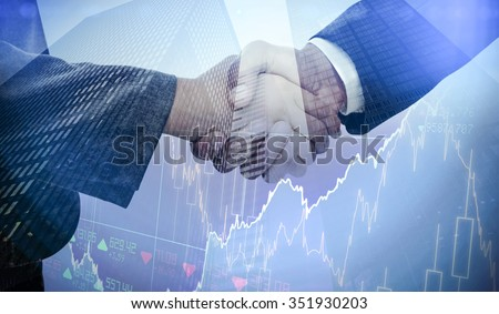 Stocks and shares against composite image of handshake between two business people - stock photo