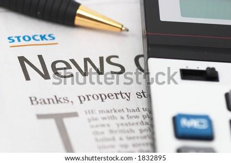 Stocks News, pen, calculator, banks, property headlines, closeup, shallow depth of field - stock photo