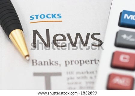 Stocks News, pen, calculator, banks, property headlines, shallow depth of field, closeup - stock photo