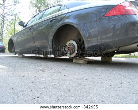 Stolen wheels - stock photo