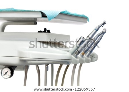 Stomatological instrument in the dentists clinic. isolated on white - stock photo