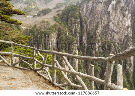 Stone and wooden fence in China's yellow mountains - stock photo