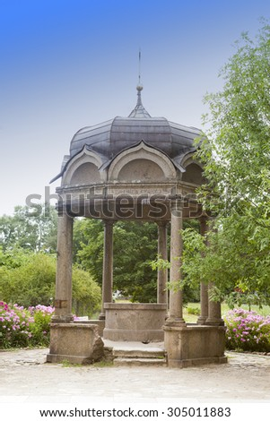 Stone arbor with a bowl with sacred source in the territory of Yuryev Monastery, Great Novgorod, Russia.