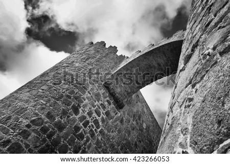 Stone arch bridge of castle Alcazar in Avila, Spain - stock photo