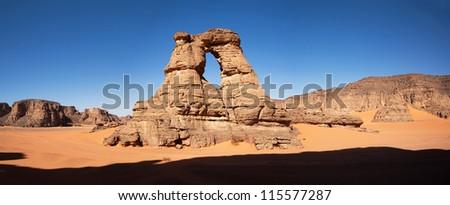 Stone arches in the Sahara Desert - stock photo