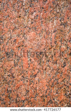Stone Background of rough red granite igneous rock, texture - stock photo