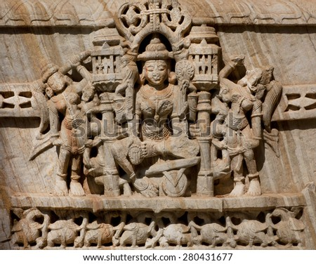 Stone bas-relief with Hindu god on the front of indian temple - stock photo
