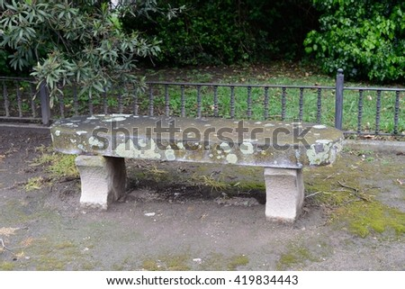 stone bench in a city park - stock photo
