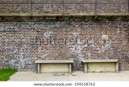 Stone benches by the city wall, seen in Rye, Kent, UK. - stock photo