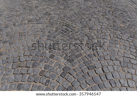 Stone blocks in the walkway -patterned paving tiles - stock photo