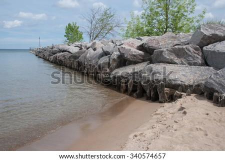 Stone breakwater protruding  into Lake Michigan - stock photo