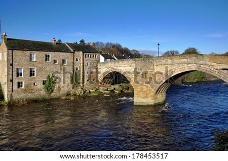 Stone bridge and building in Barnard Castle - stock photo