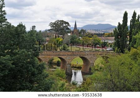 Stone bridge and church - stock photo