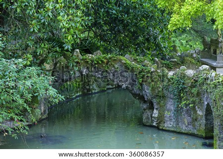 Stone bridge and pool in Quinta da Regaleira, Sintra, Portugal