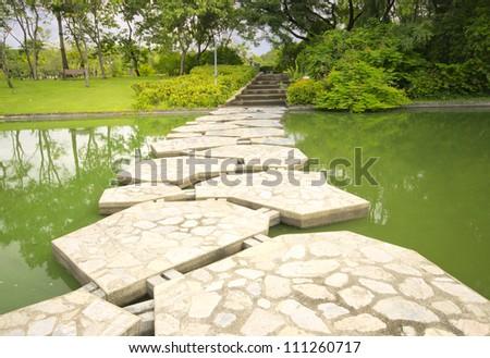 stone bridge in beautiful garden - stock photo