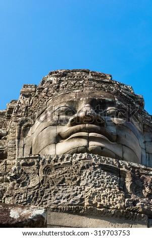 Stone Buddha head from below. Angkor wat. Cambodia - stock photo